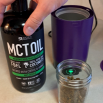 mct oil bottle next to decarbed cbd flower in glass jar