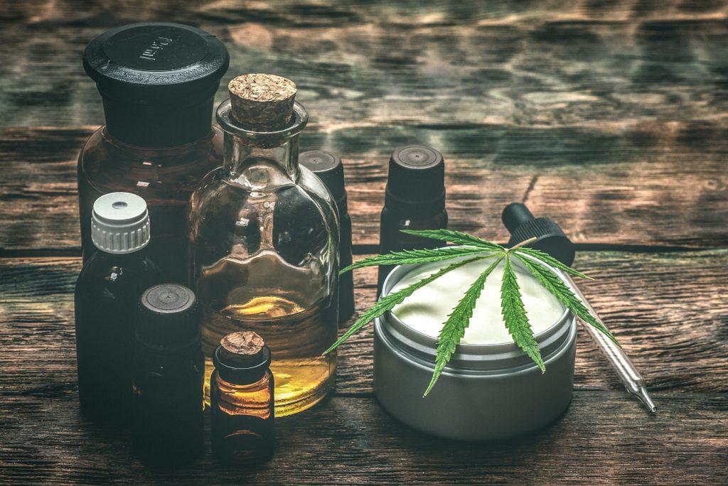 cbd-oil-tincture-bottles-lotion-leaf-min
